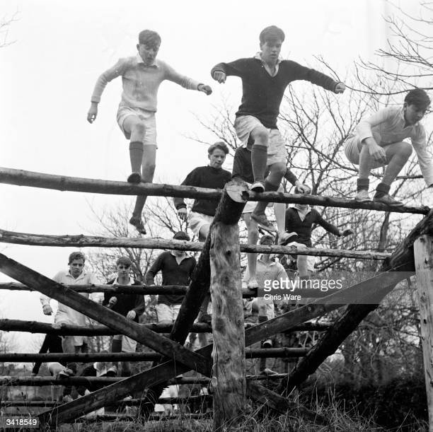 Pupils at Gordonstoun School doing physical training on an obstacle course Gordonstoun School near Elgin was founded in 1934 by German educationalist...