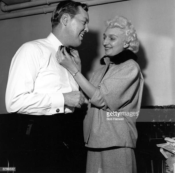 American rock 'n' roll singer and guitarist Bill Haley in the dressing room at the Dominion Theatre, Tottenham Court Road with his wife, who is...