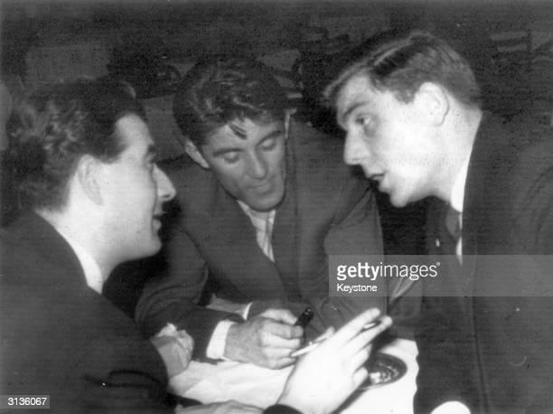 Manchester United footballer Duncan Edwards is interviewed by two Yugoslav journalists in Belgrade.