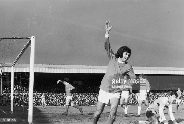 Manchester United player George Best celebrating after scoring the first goal in the fifth round of the F A Cup against Northampton