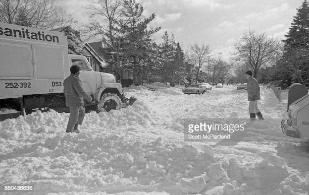 A New York City Sanitation plow clears snow at a residential intersection in Queens NY in the aftermath of the Blizzard of 1978