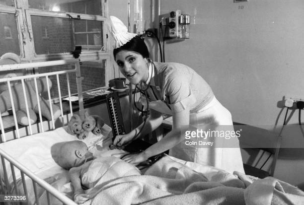 A nurse about to check a babys health at Great Ormond Street hospital