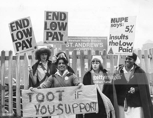 Nurses stand outside St Andrew's hospital in Bow East London holding placards during a four hour strike They are members of the 'NUPE' union which is...