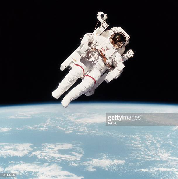 Astronaut Bruce McCandless II photographed from the Space Shuttle Challenger during the first untethered EVA made possible by his nitrogen jet...