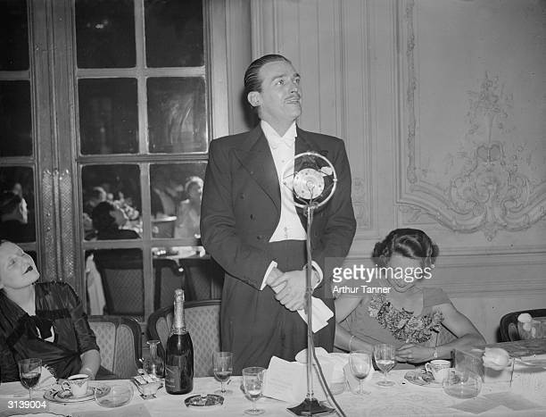 Film star Douglas Fairbanks Junior giving an after dinner speech at the Savoy Hotel, London on the occasion of a dinner-dance in aid of the 'Aged...