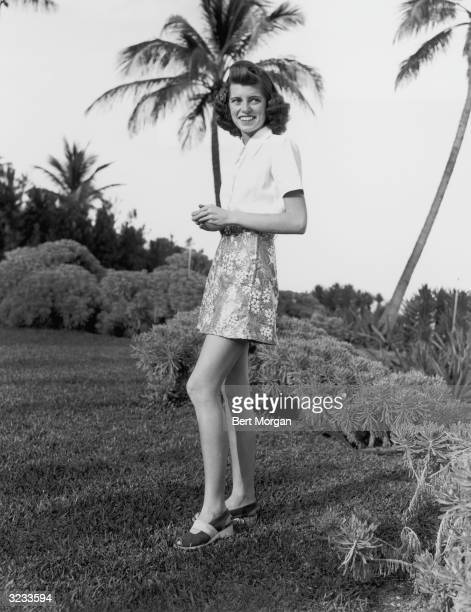 Portrait of Eunice Kennedy, daughter of US ambassador Joseph P Kennedy and sister of future US president John F Kennedy, standing on a lawn at her...