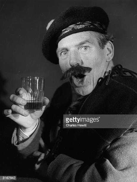 A Scotsman wearing a tamoshanter and drinking a shot of Scotch whisky Original Publication Picture Post 8212 How Britain Drinks pub1956