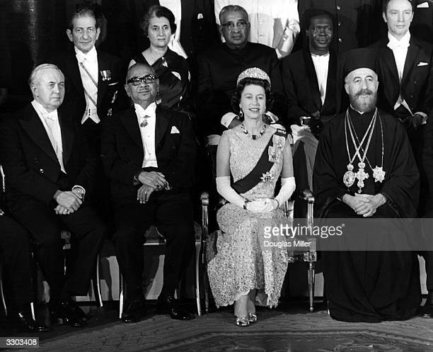 Queen Elizabeth II at Buckingham Palace with Commonwealth Prime Ministers including Indira Gandhi Harold Wilson Tunku Abdul Rahman and Archbishop...