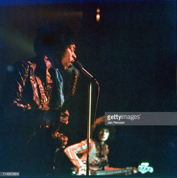 Jimi Hendrix performs live on stage at Tivoli Koncertsal Hall in Copenhagen Denmark on 7th January 1968 Behind Jimi is bass player Noel Redding