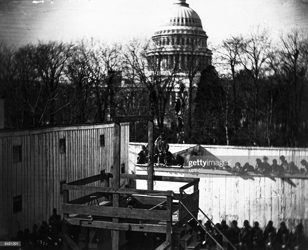 Crowds gathering in Washington DC, to witness the hanging of John Wilkes Booth's conspirators in the plot to kill President Lincoln.