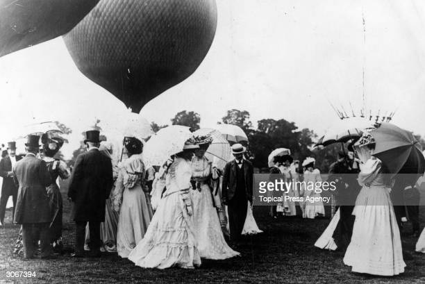 Society visitors gather to watch a balloon race at Ranelagh in Barnes West London
