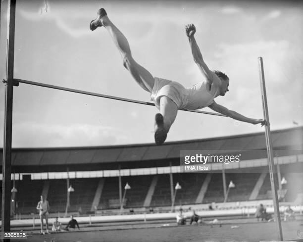 Quarterton competing in the high jump during the AAA championship at White City in London.
