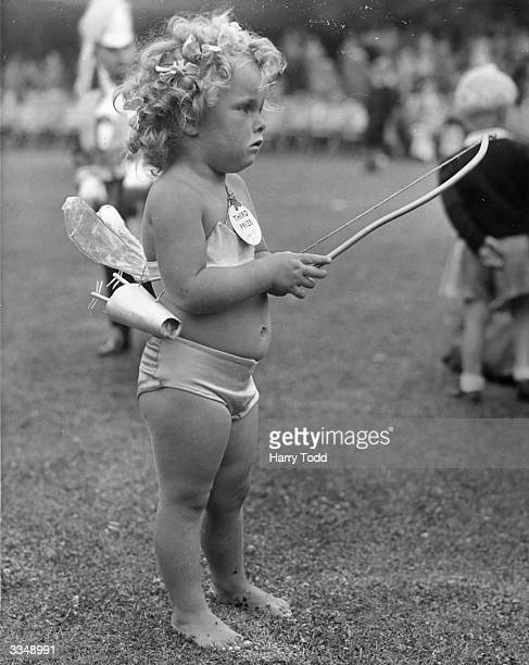 2 year old Lesley Lawrence who entered the fancy dress parade during carnival week at Hastings England wearing his cupid costume which earned him...