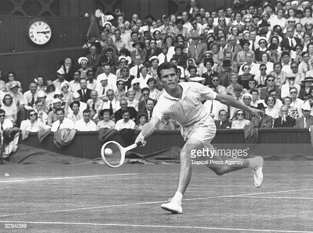 Budge Patty of the USA in action against Australia's Frank Sedgman on his way to winning the men's singles final at the Wimbledon Lawn Tennis...