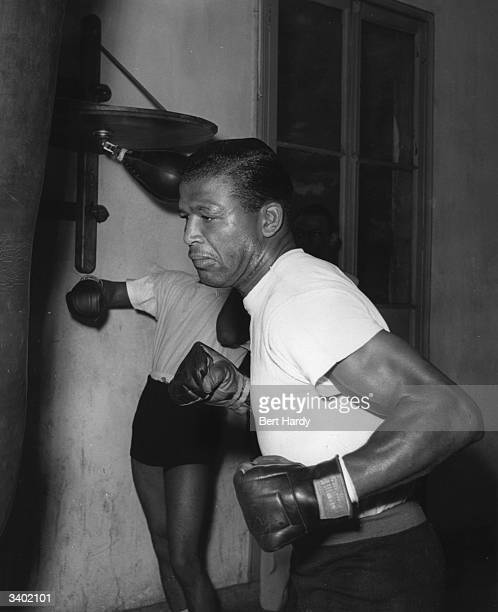 Sugar Ray Robinson who became the welterweight and middleweight boxing champion of the world training in Roger Oquinarenne's gym Paris for his fight...