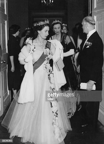 Her Majesty the Queen arriving at the Hurlingham Club to attend a coronation ball hosted by the Royal Empire Society, the Victoria League and the...