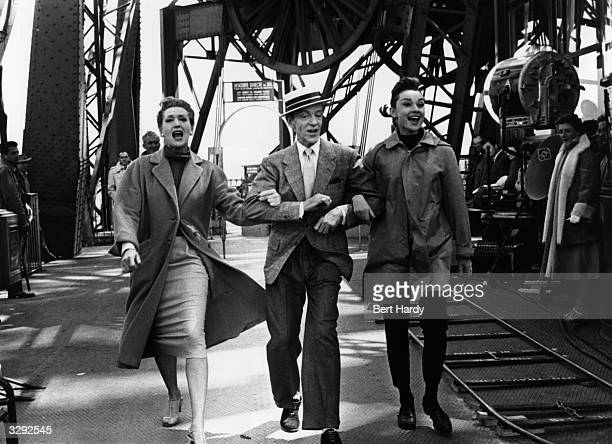 Kay Thompson Fred Astaire and Audrey Hepburn film a dance sequence for the Paramount musical 'Funny Face' directed by Stanley Donen Original...