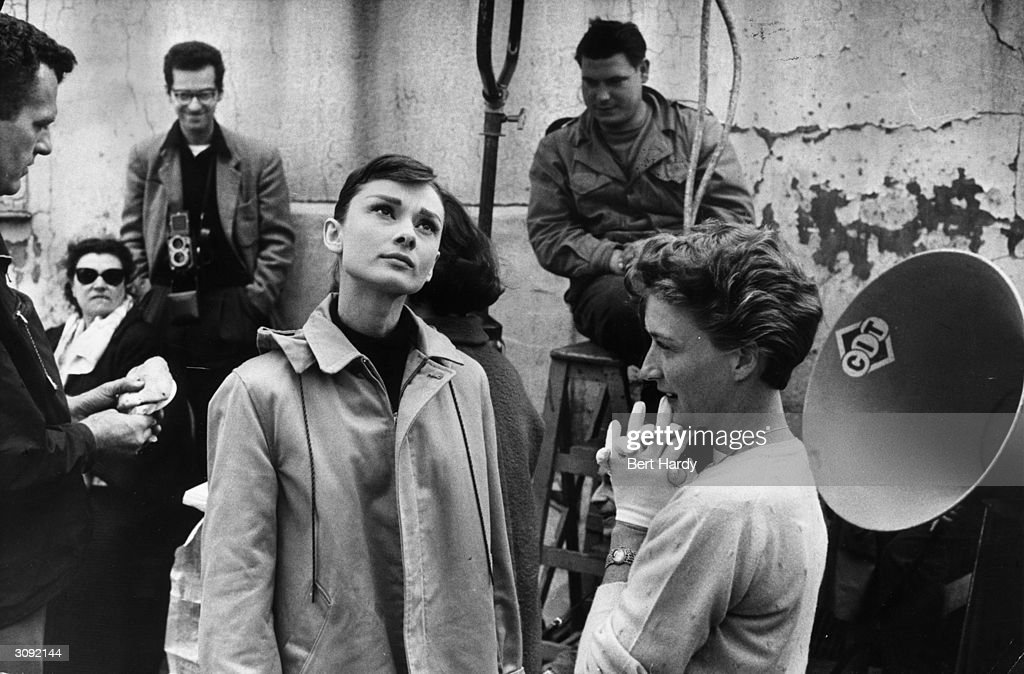 On the left, film star Audrey Hepburn (1929 - 1993) with the crew of the Paramount film 'Funny Face'. Original Publication: Picture Post - 8540 - Audrey Dances With Astaire - pub. 1956