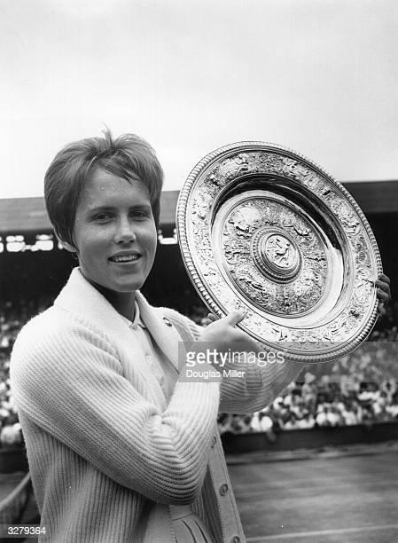 Karen Susman of the USA lifts the Women's Singles Trophy at Wimbledon after beating Vera Sukova of Czechoslovakia in the Final