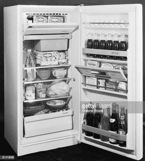 A fully stocked refrigerator filled with Bird's Eye frozen meals and bottles of drink