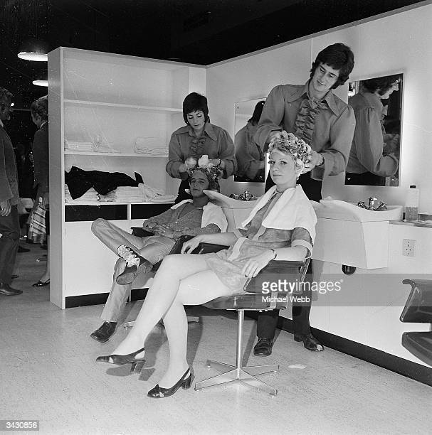 David Charkham has his hair shampooed by Rosaline Curran and Ann Cable is groomed by Michael Coleman at the new hairdressing and beauty salon at...