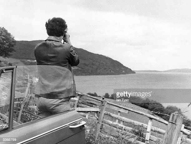 Members of the Mirisch Film Company scanning Loch Ness for the monster The company are shooting 'The Private Life of Sherlock Holmes' beside the loch...