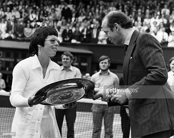 American tennis player Billie Jean King receives the trophy from the Duke of Kent after beating Evonne Goolagong to win women's singles title at the...