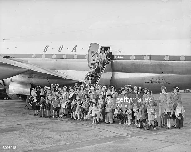 BOAC Stratocruiser at London Airport bringing 42 ex GI Brides and their children to England