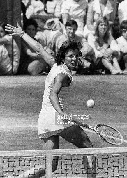 American tennis player Billie Jean King in action against Chris Evert at the Wimbledon Lawn Tennis Championships.