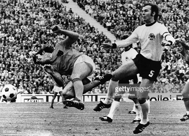 Franz Beckenbauer tackles a Dutch player during the World Cup final in Munich West Germany the hosts went on to beat Holland by 2 1