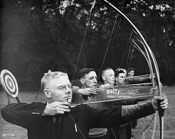 Unemployed men learning archery in the grounds of Samlesbury Hall near Blackburn. They are invited to use the facilities by the Bowmen of Pendle and...