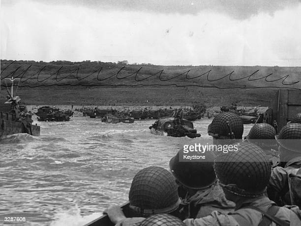 A landing craft approaching the Northern Coast of France with American soldiers on board ready to join the fighting during the Allied invasion of...