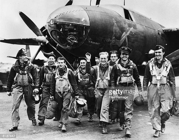 Bomber crews of the US Ninth Airforce leave their B26 Marauder aircraft after returning from a mission to support the D-Day landings in Normandy by...