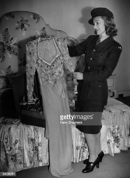 English actress Florence Desmond who has already been flown abroad to entertain British troops in France Belgium and the Azores now packs her outfits...