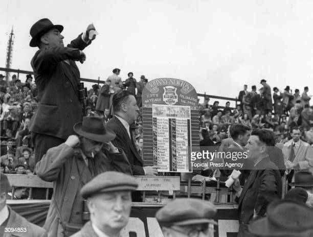 A TicTac man at the Epsom Derby conveys the prices to other bookies by coded arm movements