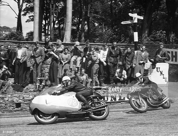 Bob McIntyre leading John Surtees at Governorfs Corner during the 1957 Senior TT McIntyre won on a Gilera machine at an average speed of 9899 mph...