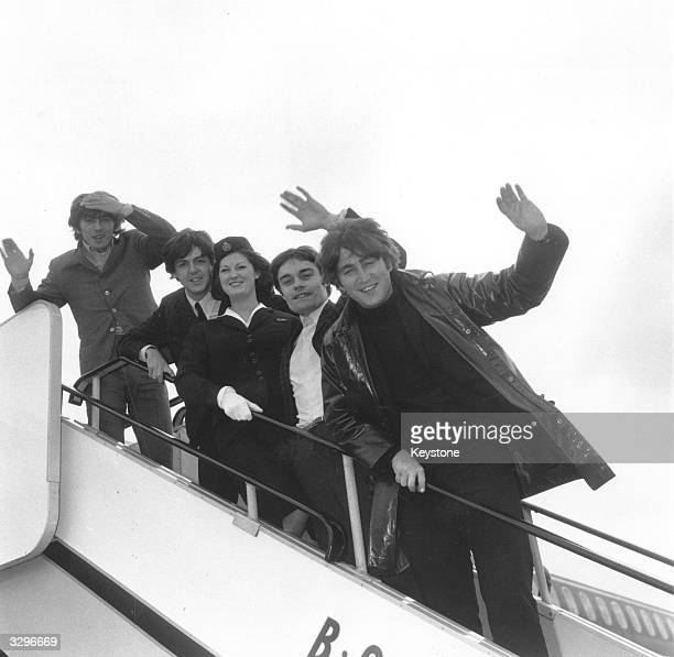 Pop group the Beatles arrived at London Airport from Holland this morning only to immediately board another aeroplane bound for Hong Kong and...