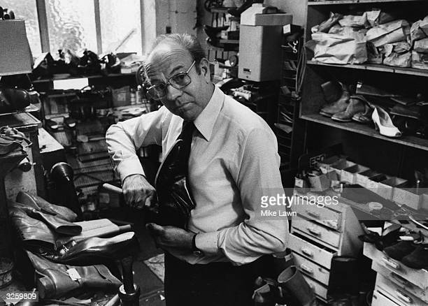 Cobbler William Crook at work in his shop at North End Parade London