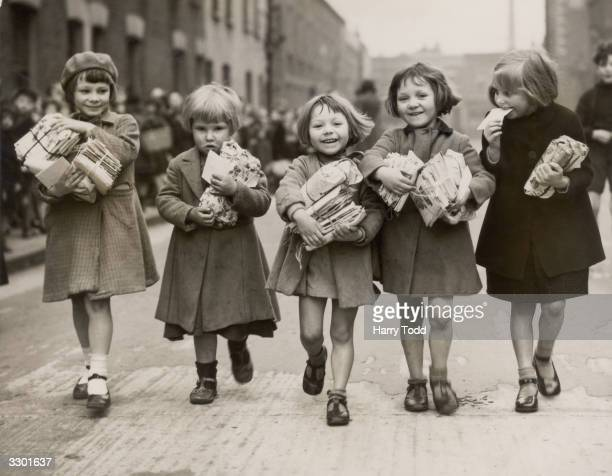 Children who are small enough to pass under an archway in Bow in the east end of London qualify for a weekly parcel of toys