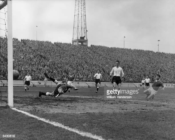 Chelsea and England footballer Peter Brabrook scoring against Luton Town at Stamford Bridge London