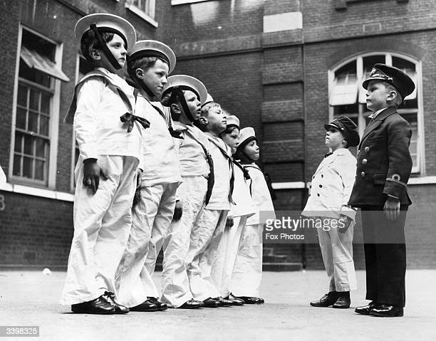 Schoolchildren at the Sir John Cass Foundation School in Aldgate London dressed as sailors for the Mayday festival