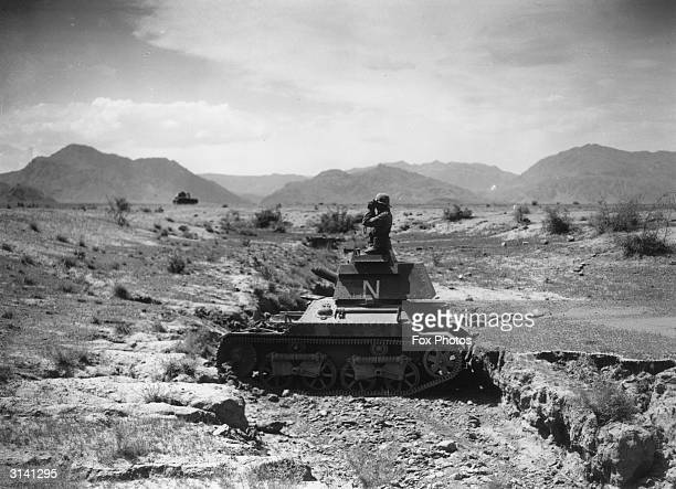 An officer of the 2nd Light Tank Company on patrol near the Khyber Pass in Afridi tribal territory In the background is the Safed Koh range of...