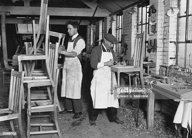 Craftsmen making chairs in a furniture workshop in High Wycombe