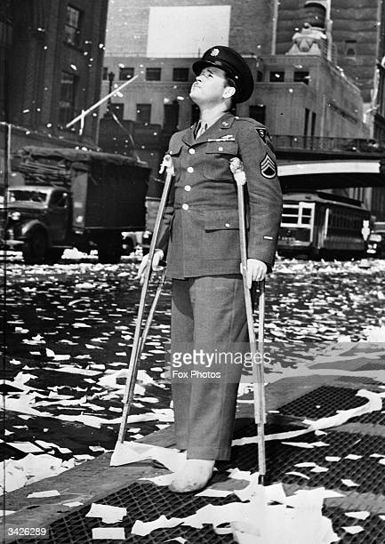A wounded American serviceman during a ticker tape parade in New York following press reports of the unconditional surrender of Germany