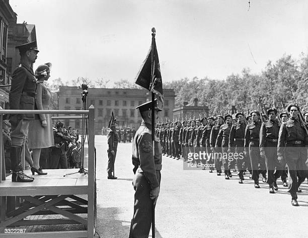 Queen Elizabeth II inspecting a parade of Grenadier Guards at Wellington Barracks.