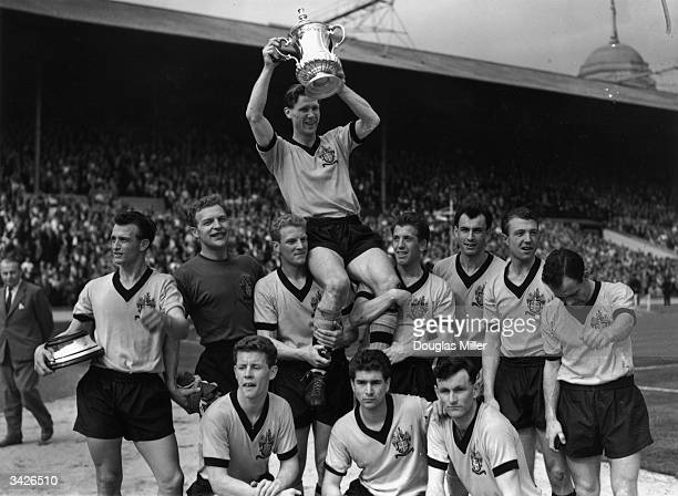 Wolverhampton Wanderers celebrating their FA Cup victory at Wembley after beating Blackburn Rovers 30 Captain Slater holds the trophy