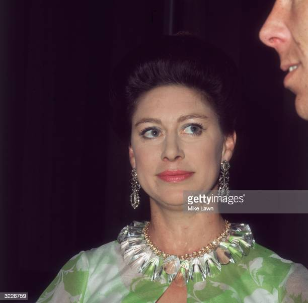 Princess Margaret at the Royal Festival Hall after a Frank Sinatra concert in aid of the NSPCC, she is looking up at her husband Lord Snowdon.