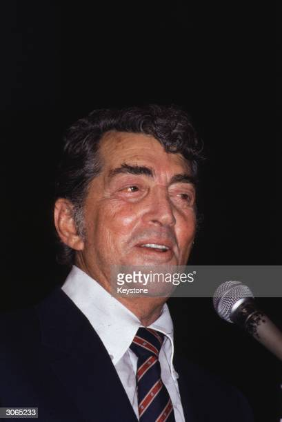 Hollywood actor singer and cabaret performer Dean Martin sings at the Variety Club luncheon in his honour at the Hilton Hotel in London