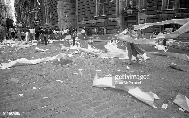 New York A woman waves to the camera as she gets tangled in printer paper and ticker tape crossing Broadway during the Vietnam veterans parade The...