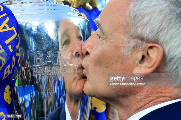 7th May 2016 - Barclays Premier League - Leicester City v Everton - Leicester manager Claudio Ranieri is reflected in the silver as he kisses the...